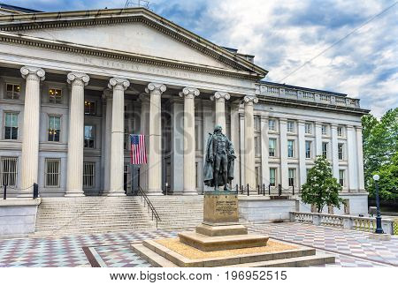 Albert Gallatin Statue US Flag US Treasury Department Washington DC. Statue by James Fraser and dedicated in 1947.