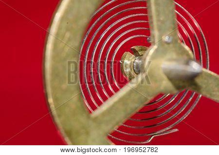 Abstract: Looking Through a Vintage Metallic Balance Wheel to Its Hairspring