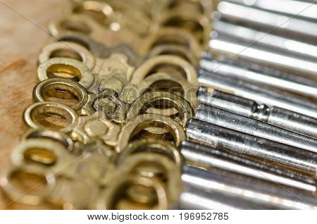 Row of Antique Pocket Watch Keys Laying on the Watchmaker's Bench