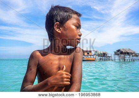 Semporna,Sabah,Malaysia-April 23,2017:Close up of the Sea Gypsy Bajau Laut boy potrait in Bodgaya Island,Semporna,Sabah,Malaysia.