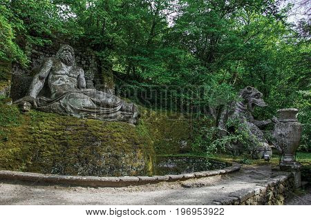 Bomarzo, Italy - May 20, 2013. View of sculpture amidst the vegetation in the Park of Bomarzo. Also known as Park of Monsters, it was created to surprise the visitor with surrealistic works in stone. Lazio region, central Italy