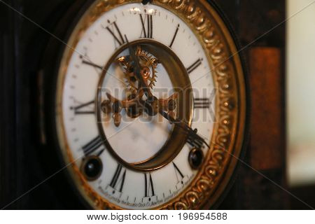 Spectacle of hour hand and minute hand of old clock