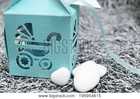 Box With Pram-shaped Cutout And Almond Confetti Inside