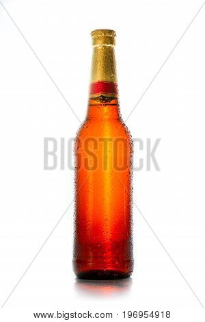 Sweaty beer bottle with water drops. Isolated on white