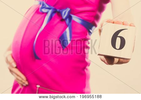 Vintage Photo, Hand Of Woman In Pregnant Showing Number Of Sixth Month Of Pregnancy, Expecting For B