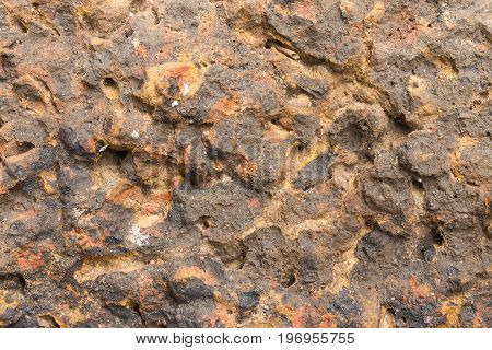 Laterite stone texture or stone background. Stone texture for design. Real stone texture. Stone texture in brown tone