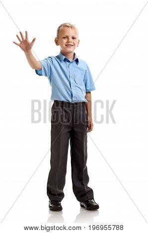 Full portrait of cute little schoolboy showing five fingers