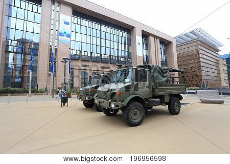 Brussels, Belgium - July 17, 2017: Military trucks opposite European Council building. Army on the streets of Brussels after the terrorist acts.