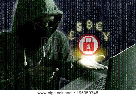 Cyber crime concept : Hacker/Cyber criminal pointing gun into laptop computer as if demanding money from oppositie site in exchange for unlocking computer.