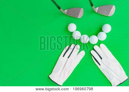 Golf concept : golve golf balls golf clubs on wooden table. Flat lay with copy space.