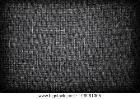 grey woven texture with vignette.