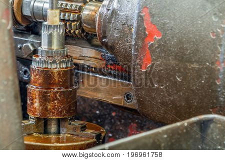 Old milling machine with oil stain, technology