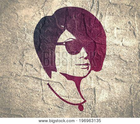 Portrait of beautiful woman in black sunglasses. Short hair. Half turn view