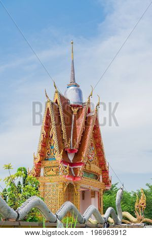 The white pagoda is on the gate of the temple. Be respectful of local people.