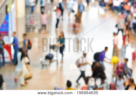 Blurred people at the airport hallway can be used as background