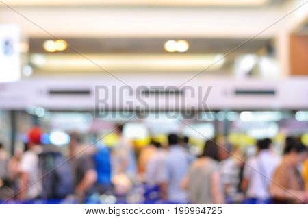 Blurred image of crowd at the hallway of airport terminal - can be used as background
