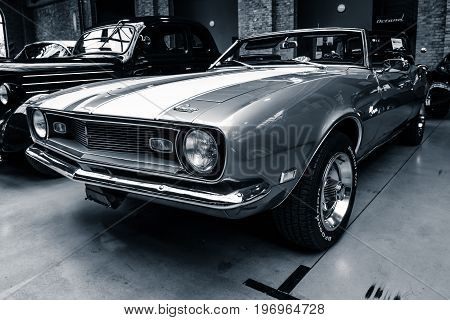 BERLIN - MAY 10 2015: Pony car Chevrolet Camaro SS (first generation) convertible 1968. Stylization. Toning. 28th Berlin-Brandenburg Oldtimer Day