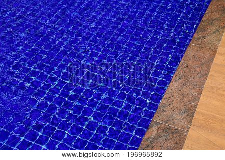 Background of water in the swimming pool with a wave.