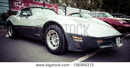 BERLIN - MAY 10 2015: Sports car Chevrolet Corvette Stingray Coupe. Stylization. Vintage toning. 28th Berlin-Brandenburg Oldtimer Day
