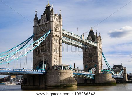 Tower Bridge in London UK. Tower Bridge is a combined bascule and suspension bridge in London built between 1886 and 1894. The bridge crosses the River Thames close to the Tower of London and has become an iconic symbol of London.