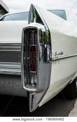BERLIN - MAY 10 2015: The rear brake lights full-size luxury car Cadillac Sedan De Ville. 28th Berlin-Brandenburg Oldtimer Day