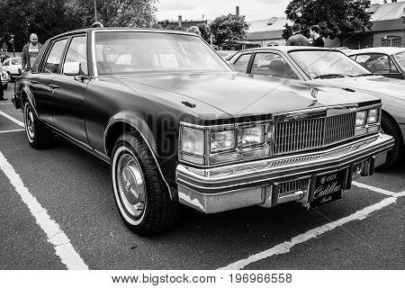 BERLIN - MAY 10 2015: Full-size luxury car Cadillac Sedan de Ville 1978. Black and white. 28th Berlin-Brandenburg Oldtimer Day