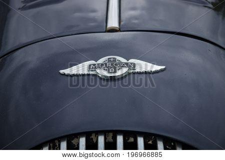 BERLIN - MAY 10 2015: Emblem of a sports car Morgan Plus 8. 28th Berlin-Brandenburg Oldtimer Day