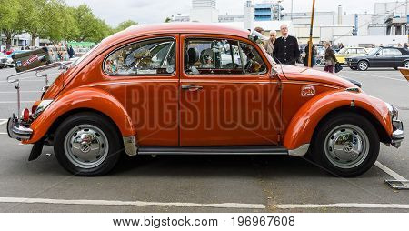 BERLIN - MAY 10 2015: Subcompact economy car Volkswagen Beetle. Side view. 28th Berlin-Brandenburg Oldtimer Day
