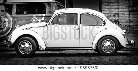 BERLIN - MAY 10 2015: Subcompact economy car Volkswagen Beetle. Side view. Black and white. 28th Berlin-Brandenburg Oldtimer Day