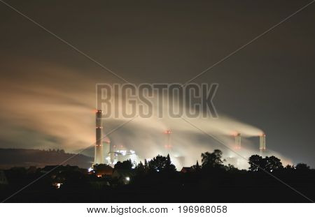 an old coal power plant at night with long time exposure