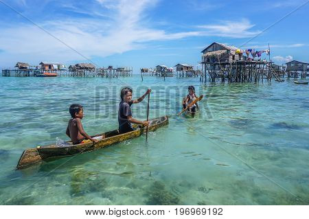 Semporna,Sabah,Malaysia-Apr 24,2017:Sea Gypsy kids on an unique handmade boat in Bodgaya island,Semporna,Sabah,Borneo,Malaysia.