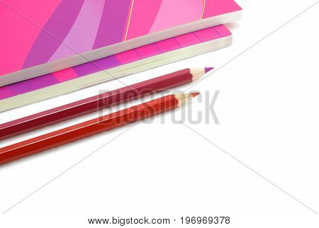 Two pencils and two book are on white background
