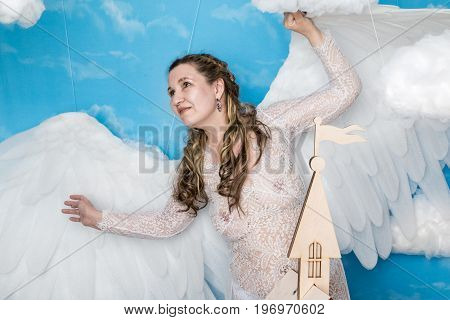 Ugly Woman In A White Dress With White Wings