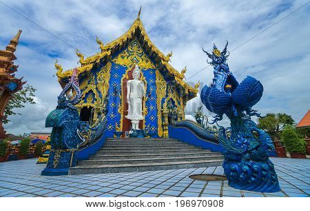Blue temple of Rong Sua Ten temple with blue sky background is poppula tourist attraction of  Chiang Rai Province, Thailand.