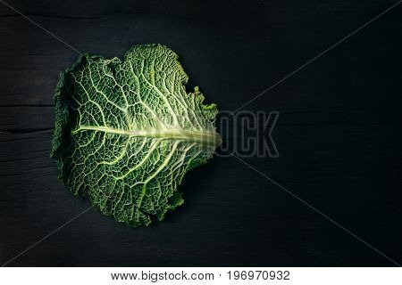 Green savoy cabbage on the wood table