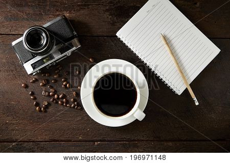 creative View from above with copy space office table Mobile phone with cup of coffee and notebook on wooden background. minimal concept. Flat lay background