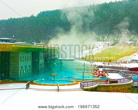 Egerszalok, Hungary - January 06, 2016: The people resting at pool at Saliris resort. The Egerszalok spa pools contain water rich in calcium, magnesium, and hydrocarbonate minerals at Egerszalok, Hungary on January 06, 2016.