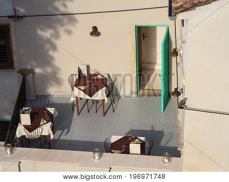 MOTOVUN, CROATIA - JULY, 12: View of three Restaurant tables in a terrace on July 12, 2017