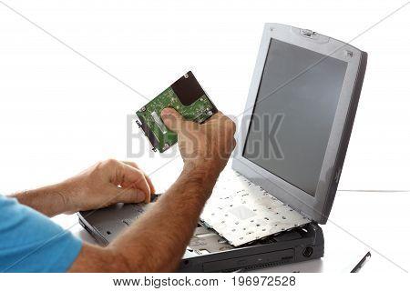 computer expert is repairing a defect notebook