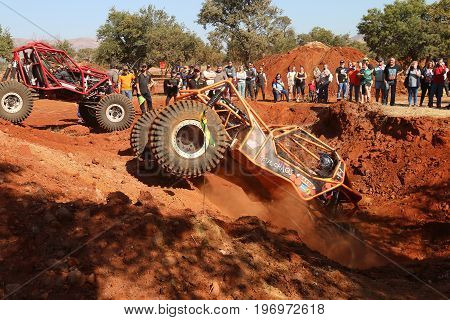 Car Ramping Out Steep Dugout, Front Wheels Suspended