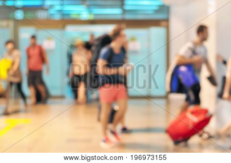 Blurred image of people as arrival passengers at the airport terminal