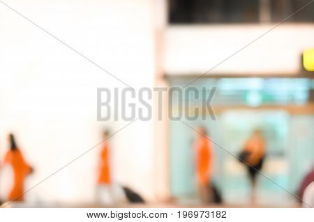 Blurred image of arrival people passengers   aircrews at the airport terminal