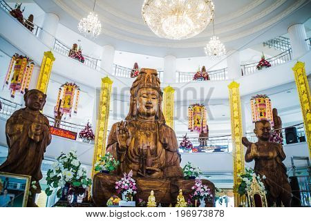 Chiang Rai Thailand - July 12 2017: Wooden Guanyin Carve The Goddess Of Compassion (In Chinese Buddhism) Inside Sanctuary At Wat Huai Pla Kang.