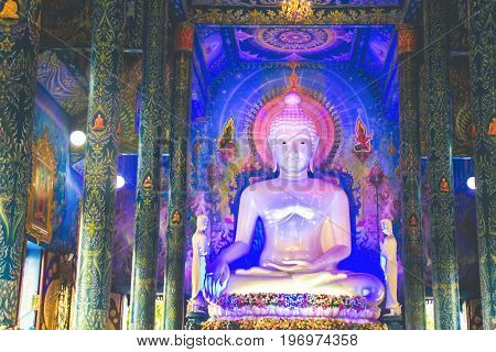 Chiang Rai Thailand - July 12 2017: Image Of Buddha Inside Sanctuary At Wat Rong Sua Ten Or Blue Temple.