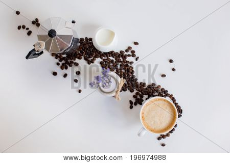 Top View Of French Press, Cup Of Coffee, Milk Jar And Lavender Drink With Scattered Coffee Beans, Is