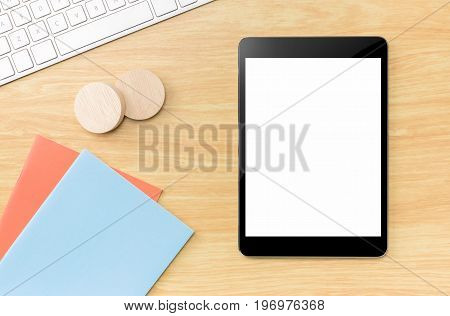 Top View Of Empty Screen Tablet With Blue Notebook And Keyboard On Wooden Beige Color Table Top,mock