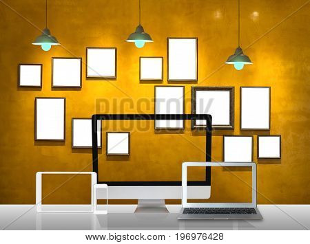 Workspace of computer set and Vintage photo frame wall background and light Interior gallery design and workplace concept
