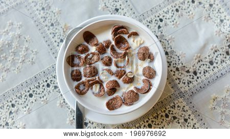 chocolate Corn flakes and oat flakes with milk