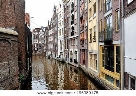 Amsterdam Holland Europe - scenic view of the canal and buildings facade