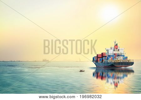 Logistics and transportation of International Container Cargo ship in the ocean at sea sunset time Freight Transportation Shipping Nautical Vessel